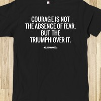 COURAGE IS NOT THE ABSENCE OF FEAR, BUT THE TRIUMPH OVER IT. NELSON MANDELA QUOTES. (DARK)