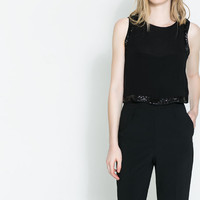 TOP WITH HEM DETAIL