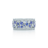 Tiffany & Co. - Tiffany Cobblestone band ring in platinum with diamonds, 9.5 mm wide.