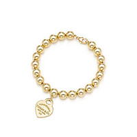 Tiffany & Co. - Return to Tiffany™ small heart tag in 18k gold on a bead bracelet.