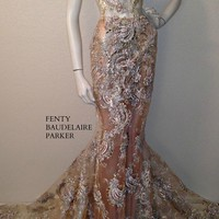 The Fenty Baudelaire Parker Fancy Gown, Sequins, Tinsel, Micro Fiber Embroidery on mesh/net. Pattern Embroidery on hem of gown.