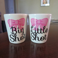 Big Shot Little Shot set of two white shot glasses with bow design. Great gift for sisters or sorority big little.