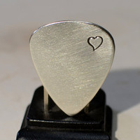 Sterling silver guitar pick brimming with love and a heart